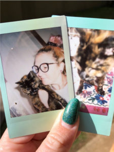 Sophie and her cat in polaroids